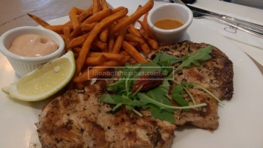 Flattened Chicken - Grilled chicken breast served with peri-peri sauce on the side and sweet potato fries