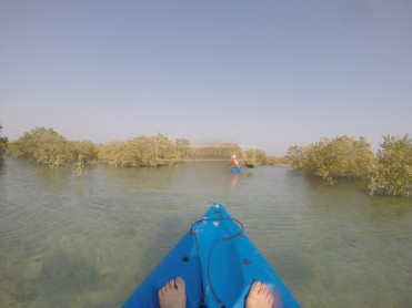 My ugly feet and a smudged GoPro screen, kayaking amongst the mangroves