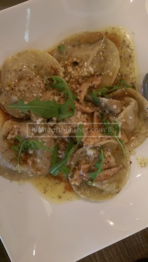 Ravioli con Osso buco - Truffle ravioli with braised veal shank and parmesan filling, artichokes and sautéed wild mushrooms